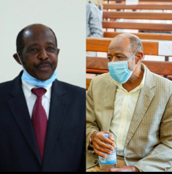 Two side by side photos of Paul Rusesabagina wearing a black suit with a red tie and a grey suit without a tie as he wears a mask during Rwandan court proceedings during his illegal detention.